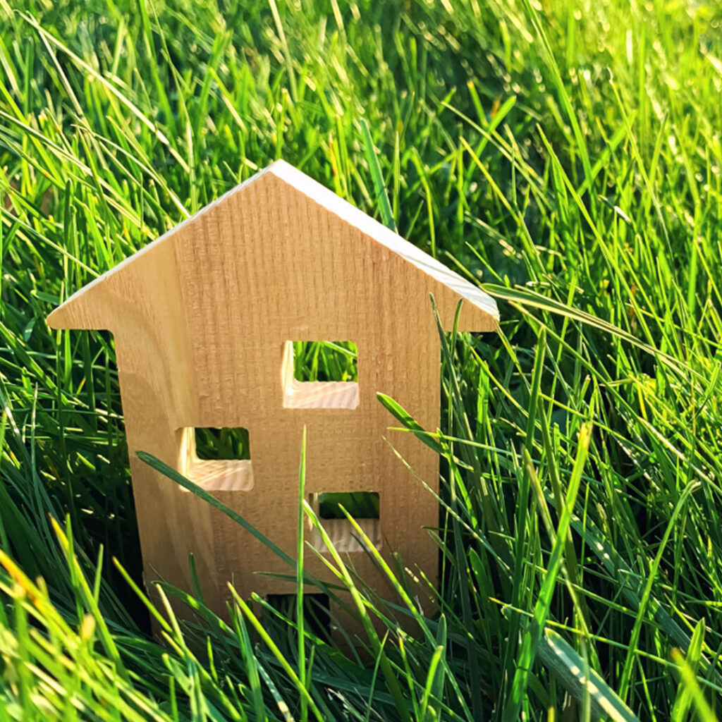 A wooden house sitting in grass.